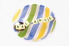 Balanza en un cuenco Foto de archivo libre de regalías