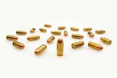 Balas de la pistola automática aisladas en blanco foto de archivo libre de regalías