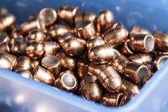 Balas de la pistola en una caja Foto de archivo libre de regalías