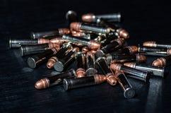 Balas do rifle sobre a tabela Foto de Stock Royalty Free