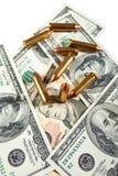 Balas e dólares Foto de Stock
