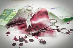 Balas, sangue, atadura e dinheiro fotografia de stock