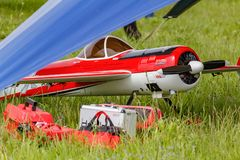 Balashikha, Moscow region, Russia - May 25, 2019: Big scale radio controlled model of aerobatic aircraft YAK-55 with gasoline. Engine on a green lawn. Aviation royalty free stock images