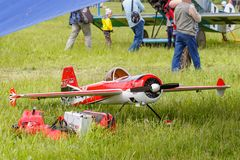 Balashikha, Moscow region, Russia - May 25, 2019: Big scale radio controlled model of aerobatic aircraft YAK-55 with gasoline. Engine on a green lawn. Aviation royalty free stock photography