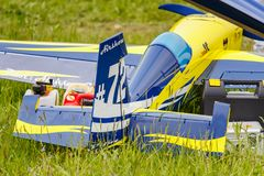 Balashikha, Moscow region, Russia - May 25, 2019: Big scale RC model of aerobatic aircraft Extra-330SC with gasoline engine. Closeup on a green lawn. Aviation stock photos