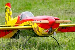 Balashikha, Moscow region, Russia - May 25, 2019: Big scale RC model of aerobatic aircraft Extra-330SC with gasoline engine. Closeup on a green lawn. Aviation royalty free stock photo