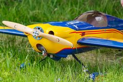 Balashikha, Moscow region, Russia - May 25, 2019: Big scale RC model of aerobatic aircraft Extra-330SC with gasoline engine. Closeup on a green lawn. Aviation royalty free stock photography