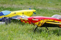 Balashikha, Moscow region, Russia - May 25, 2019: Big scale RC model of aerobatic aircrafts with gasoline engine closeup on a. Green lawn. Aviation festival Sky stock images
