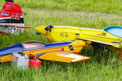Balashikha, Moscow region, Russia - May 25, 2019: Big scale RC model of aerobatic aircrafts with gasoline engine closeup on a. Green lawn. Aviation festival Sky stock photo