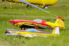 Balashikha, Moscow region, Russia - May 25, 2019: Big scale RC model of aerobatic aircrafts with gasoline engine closeup on a. Green lawn. Aviation festival Sky royalty free stock images