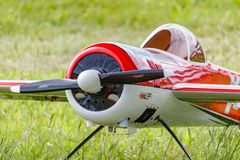 Balashikha, Moscow region, Russia - May 25, 2019: Big scale RC model of russian aerobatic aircraft YAK-55 with gasoline engine. Closeup on a green lawn royalty free stock image