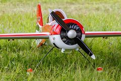 Balashikha, Moscow region, Russia - May 25, 2019: Big scale RC model of russian aerobatic aircraft YAK-55 with gasoline engine. Closeup on a green lawn royalty free stock images