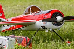 Balashikha, Moscow region, Russia - May 25, 2019: Big scale RC model of russian aerobatic aircraft YAK-55 with gasoline engine. Closeup on a green lawn stock photography