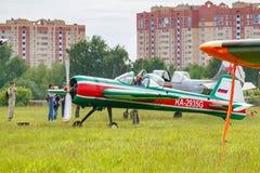 Balashikha, Moscow region, Russia - May 25, 2019: Russian aerobatic aircraft Yakovlev YAK-55M RA-2935G parked on a green grass of. Airfield Chyornoe at Aviation royalty free stock image