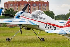 Balashikha, Moscow region, Russia - May 25, 2019: Russian sports and aerobatic aircraft SP-55M RA-2937G parked on a green grass of. Airfield Chyornoe at royalty free stock photography