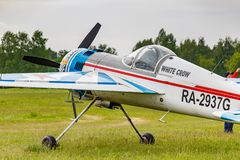 Balashikha, Moscow region, Russia - May 25, 2019: Russian sports and aerobatic aircraft SP-55M RA-2937G parked on a green grass of. Airfield Chyornoe at royalty free stock images