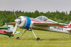 Balashikha, Moscow region, Russia - May 25, 2019: Russian sports and aerobatic aircraft SP-55M RA-2937G parked on a green grass of. Airfield Chyornoe at stock photos