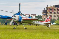 Balashikha, Moscow region, Russia - May 25, 2019: Russian sports and aerobatic aircraft SP-55M RA-2937G parked on a green grass of. Airfield Chyornoe at royalty free stock photos