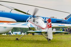 Balashikha, Moscow region, Russia - May 25, 2019: Russian sports and aerobatic aircraft SP-55M RA-2937G parked on a green grass of. Airfield Chyornoe at royalty free stock image