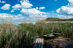 Balaton lake. Hungary with the Tihany peninsula, fishing boat and a pier in the reedy Stock Photos