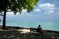 Balatonfured, June 02 2018 - Rest on a bench on Tagore promenade in Balatonfured. Lake Balaton  is a freshwater lake in Transdanubian region of Hungary. It is Royalty Free Stock Photography