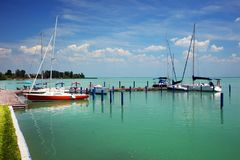 Balatonfured, June 02 2018 - Sailboats on the Balaton Lake. Balatonfured marina. Lake Balaton  is a freshwater lake in Transdanubian region of Hungary. It is the Royalty Free Stock Photo