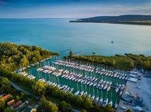 Balatonfuzfo, Hungary - Yacht marina at Balatonfuzfo at sunset with beautiful turquoise water. Balatonalmadi at background royalty free stock photos