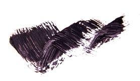 Balayez le strok de la nuance noire du mascara sur le blanc images libres de droits