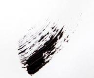 Balayez le strok de la nuance noire du mascara sur le blanc image stock
