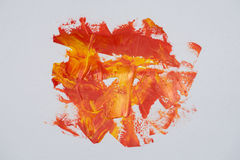Balayez les couleurs rouges et jaunes de peinture à l'huile de courses sur un backgro blanc Image stock