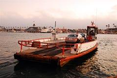 Balboa Island Ferry. The Balboa Ialnd Ferry, carrying one car, leaves the port in Newport Beach heading to Balboa Island Stock Images