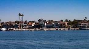 Balboa Island bay front skyline. In Newport Beach California on a sunny day in spring royalty free stock photography
