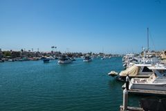 Waterway near Balboa Island with numerous pleasure boats docked along the sides and in the center of the waterway. Balboa Island, California - October 12, 2018 royalty free stock photos