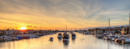 Balboa Island harbor at sunset. With ships and sailboats visible from the bridge that leads into Balboa Island, Southern California, USA royalty free stock images