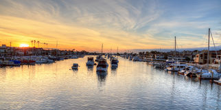 Balboa Island harbor at sunset. With ships and sailboats visible from the bridge that leads into Balboa Island, Southern California, USA royalty free stock image