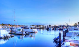 Balboa Island harbor at sunset. With ships and sailboats visible from the bridge that leads into Balboa Island, Southern California, USA stock image