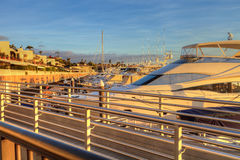 Balboa Island harbor at sunset. With ships and sailboats visible from the bridge that leads into Balboa Island, Southern California, USA stock photography