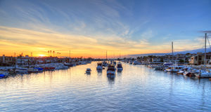 Balboa Island harbor at sunset. With ships and sailboats visible from the bridge that leads into Balboa Island, Southern California, USA stock photos