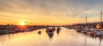 Balboa Island harbor at sunset. With ships and sailboats visible from the bridge that leads into Balboa Island, Southern California, USA stock images