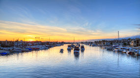 Balboa Island harbor at sunset. With ships and sailboats visible from the bridge that leads into Balboa Island, Southern California, USA royalty free stock photo