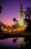 Balboa Park at Dusk. California Tower, dome, West Gate, El Prado, eucalyptus trees, Plaza de Panama fountain, Balboa Park, San Diego, California, vertical Stock Image
