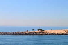 Balboa Peninsula -- Wedge. A view of world famous Wedge at Balboa Peninsula, California from Corona del Mar royalty free stock photo