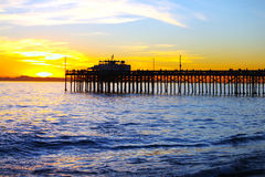 Balboa Pier. The sun starting to set on Balboa Pier in Newport Beach in California with Catalina Island in the background royalty free stock photos
