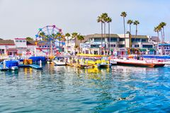 Balboa Pier at Newport Beach, California. NEWPORT BEACH, CA, USA - MAR 29, 2018: Popular pier at Balboa peninsula in Southern California with ferris wheel royalty free stock photography