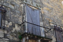 Balcón cerrado. Balcony walled by a rag in an old abandoned palace whose stones highlight a gray and green hues by moisture Royalty Free Stock Photo