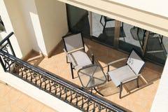 Balcón con muebles Foto de archivo libre de regalías