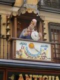 Balcón de la tienda de los relojeros Foto de archivo libre de regalías