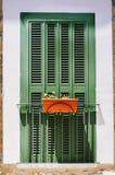 Balcón francés con la ventana cerrada Fotografía de archivo libre de regalías