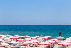The Balchik seaside, beach with sands, sun umbrellas and blue wa Stock Image