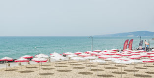 The Balchik seaside, beach with sands, sun umbrellas and blue water Royalty Free Stock Image
